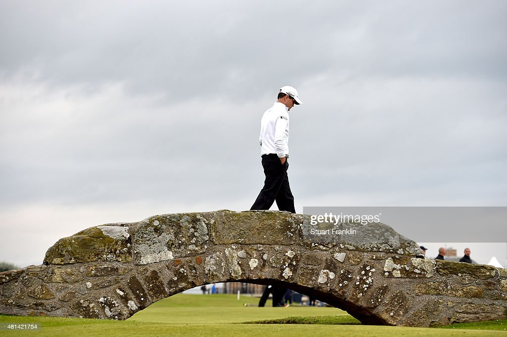 Zach Johnson of the United States walks over the Swilcan Bridge on the 18th hole in the playoff during the final round of the 144th Open Championship...