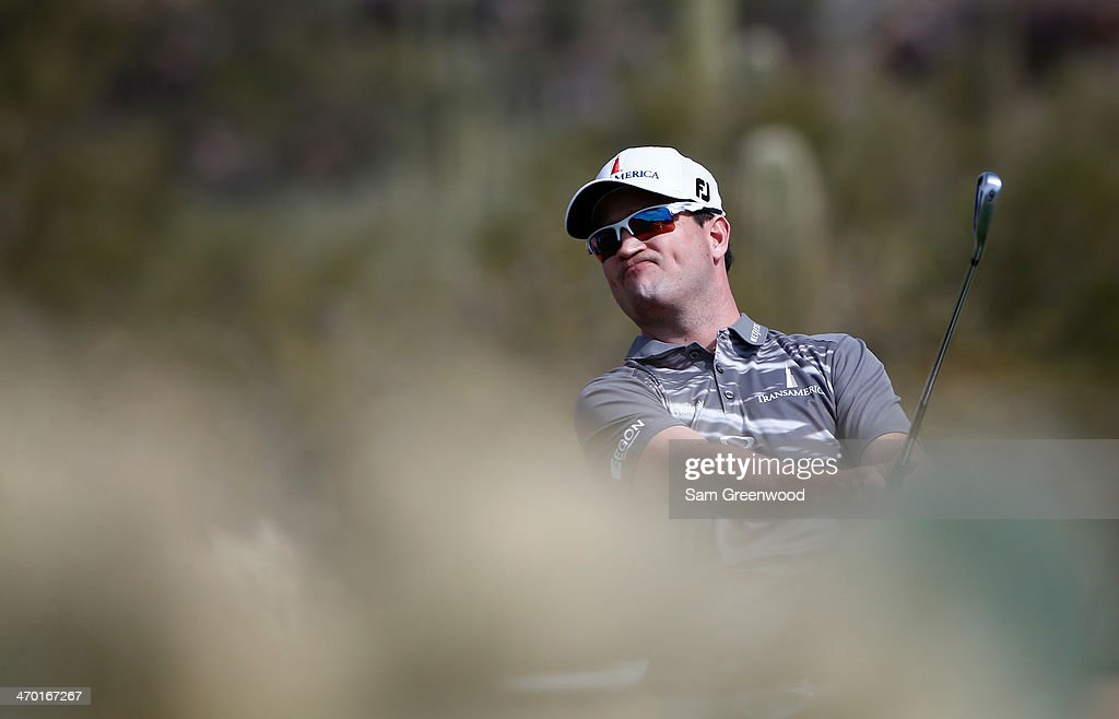 <a gi-track='captionPersonalityLinkClicked' href=/galleries/search?phrase=Zach+Johnson+-+Golfer&family=editorial&specificpeople=217976 ng-click='$event.stopPropagation()'>Zach Johnson</a> plays a shot during a practice round prior to the World Golf Championships-Accenture Match Play Championship at the Golf Club at Dove Mountain on February 18, 2014 in Marana, Arizona.