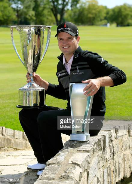 Zach Johnson poses with the JK Wadley Trophy and BMW Championship Trophy after winning the BMW Championship at Conway Farms Golf Club on September 16...