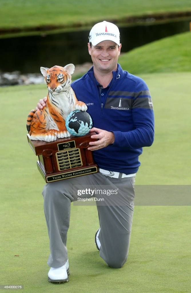 Zach Johnson poses with the trophy after the final round of the Northwestern Mutual World Challenge at Sherwood Country Club on December 8 2013 in...