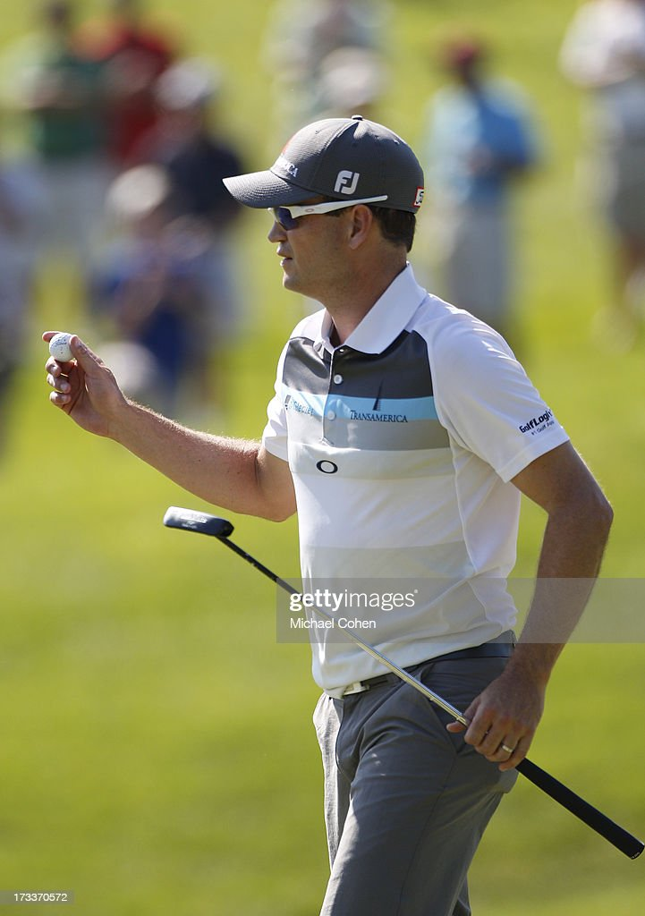 Zach Johnson reacts to his birdie putt on the 14th green during the second round of the John Deere Classic held at TPC Deere Run on July 12, 2013 in Silvis, Illinois.