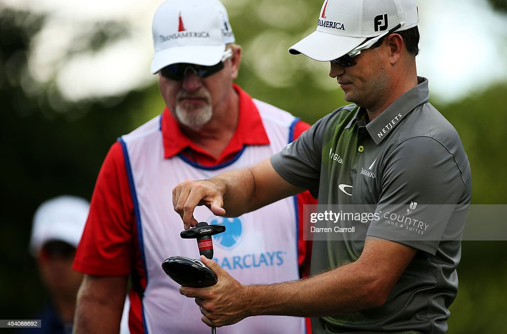 Zach Johnson replaces a club head after cracking his driver during the final round of The Barclays at The Ridgewood Country Club on August 24, 2014 in Paramus, New Jersey.