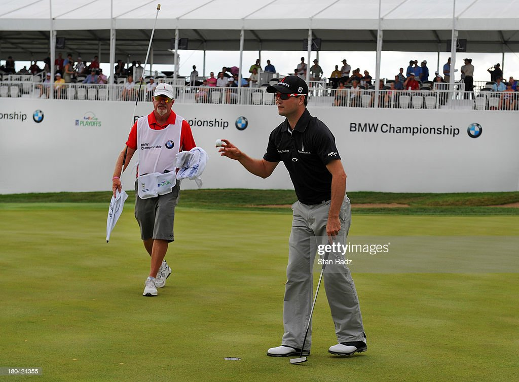 Zach Johnson waves his golf ball as he exits the 18th green during the first round of the BMW Championship at Conway Farms Golf Club on September 12, 2013 in Lake Forest, Illinois.