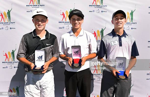 R Zach Jones Chase Hascup and Daniel Uranga pose with their medals after finishing third second and first in the Overall competition in the Boys 1415...
