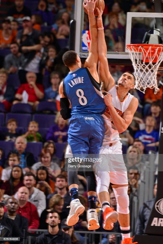 Zach LaVine #8 of the Minnesota Timberwolves dunks the ball over Alex Len #21 of the Phoenix Suns on November 25, 2016 at Talking Stick Resort Arena in Phoenix, Arizona.