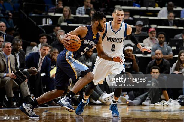 Zach LaVine of the Minnesota Timberwolves guards against Andrew Harrison of the Memphis Grizzlies during the preseason game on October 19 2016 at...