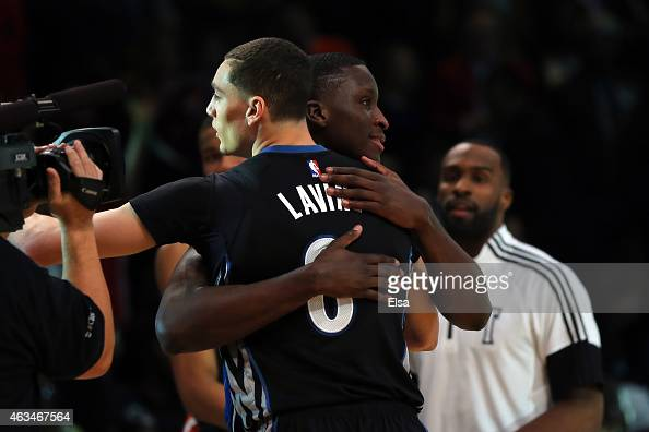 Zach LaVine of the Minnesota Timberwolves hugs Victor Oladipo of the Orlando Magic during the Sprite Slam Dunk Contest as part of the 2015 NBA...
