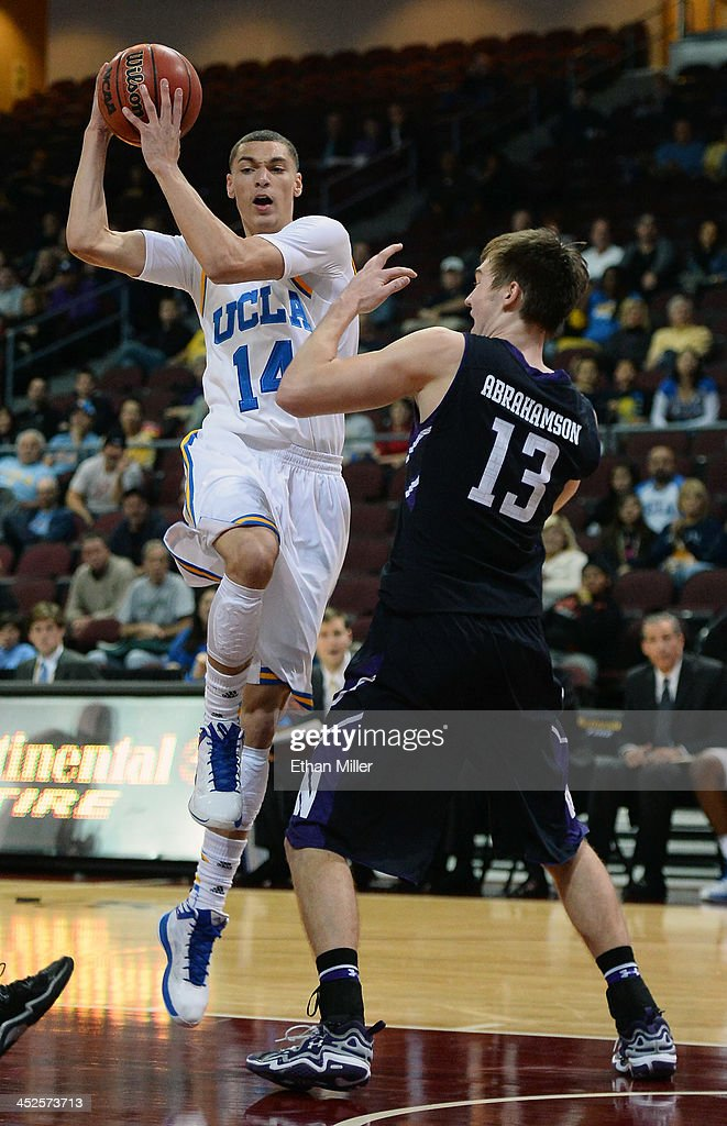 Zach LaVine #14 of the UCLA Bruins drives against Kale Abrahamson #13 of the Northwestern Wildcats during the Continental Tire Las Vegas Invitational at the Orleans Arena on November 29, 2013 in Las Vegas, Nevada. UCLA won 95-79.