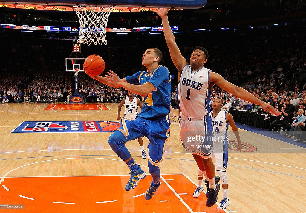 Zach LaVine #14 of the UCLA Bruins goes to the hoop against <a gi-track='captionPersonalityLinkClicked' href=/galleries/search?phrase=Jabari+Parker&family=editorial&specificpeople=9330340 ng-click='$event.stopPropagation()'>Jabari Parker</a> #1 of the Duke Blue Devils during the CARQUEST Auto Parts Classic on December 19, 2013 at Madison Square Garden in New York City.