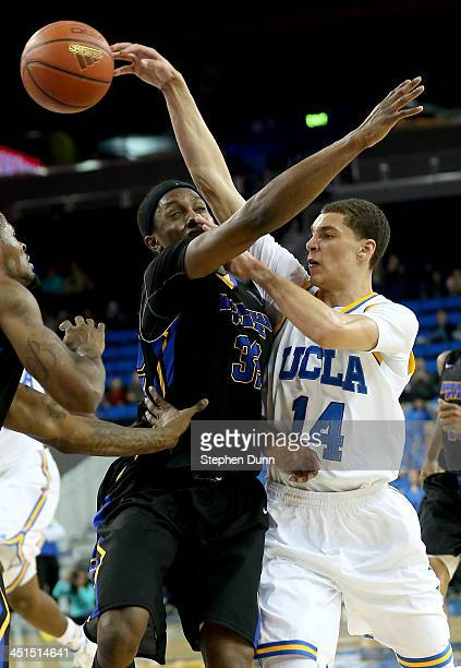 Zach LaVine of the UCLA Bruins throws a pass over Brent Arrington of the Morehead State Eagles at Pauley Pavilion on November 22 2013 in Los Angeles...
