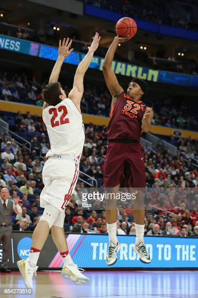 Zach LeDay of the Virginia Tech Hokies shoots against Ethan Happ of the Wisconsin Badgers in the second half during the first round of the 2017 NCAA...