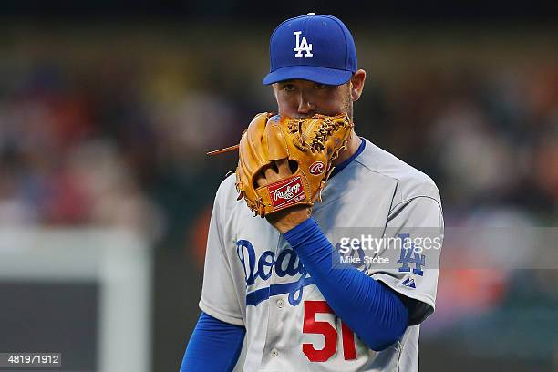 Zach Lee of the Los Angeles Dodgers bites his glove following the third out of the first inning against the New York Mets at Citi Field on July 25...