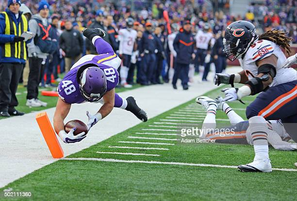Zach Line of the Minnesota Vikings carries in a touchdown after Shea McClellin of the Chicago Bears attempts the tackle in the fourth quarter on...