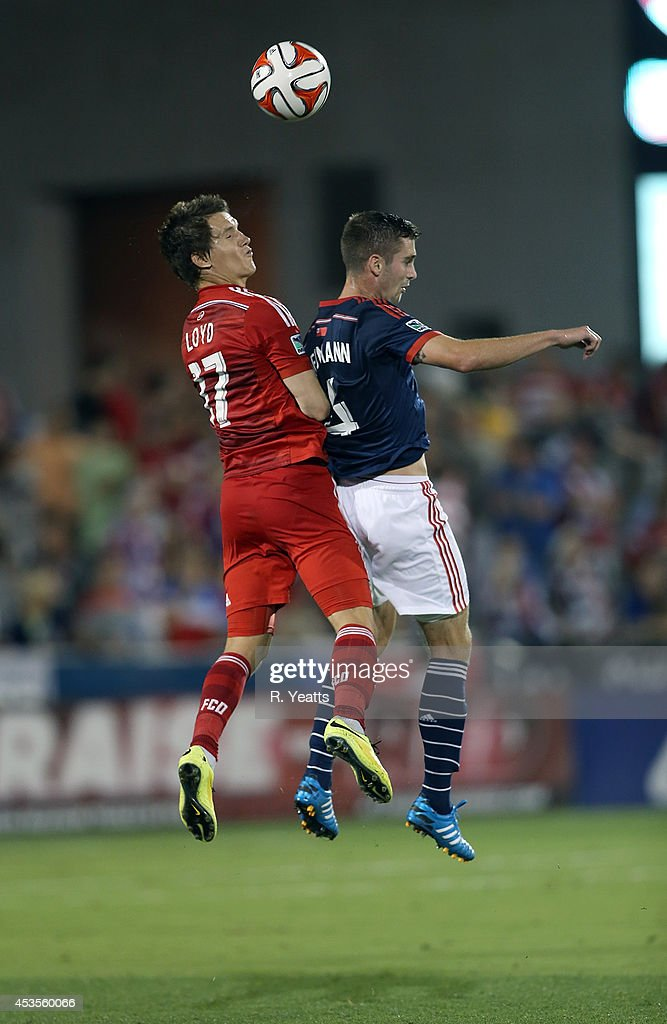 <a gi-track='captionPersonalityLinkClicked' href=/galleries/search?phrase=Zach+Loyd&family=editorial&specificpeople=5640132 ng-click='$event.stopPropagation()'>Zach Loyd</a> #17 of FC Dallas and Steve Neumann #4 of New England Revolution go up to head the ball at Toyota Stadium on July 19, 2014 in Frisco, Texas.