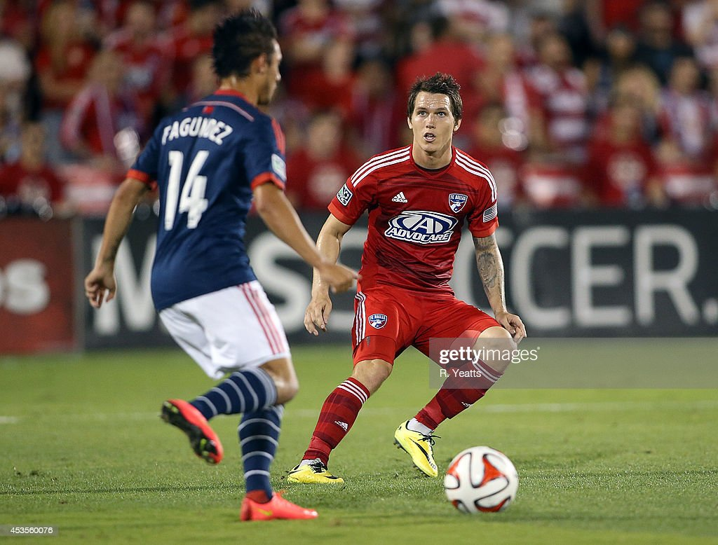 <a gi-track='captionPersonalityLinkClicked' href=/galleries/search?phrase=Zach+Loyd&family=editorial&specificpeople=5640132 ng-click='$event.stopPropagation()'>Zach Loyd</a> #17 of FC Dallas handles the ball in front of Diego Fagundez #14 of New England Revolution at Toyota Stadium on July 19, 2014 in Frisco, Texas.