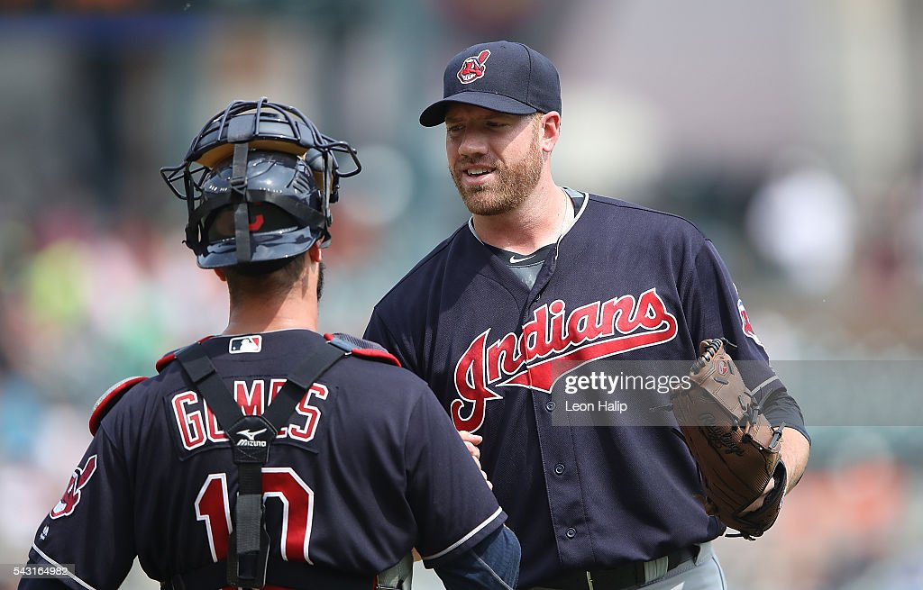 Zach McAllister #34 and catcher Yan Gomes #10 of the Cleveland Indians celebrate a win over the Detroit Tigers on June 26, 2016 at Comerica Park in Detroit, Michigan. The Indians defeated the Tigers 9-3.