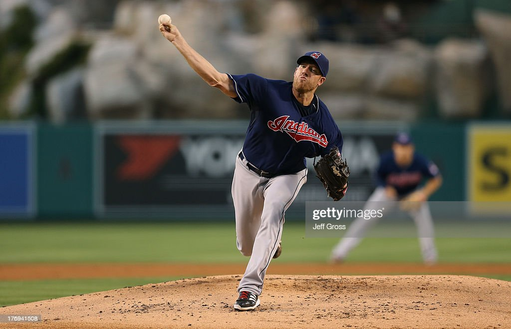 <a gi-track='captionPersonalityLinkClicked' href=/galleries/search?phrase=Zach+McAllister&family=editorial&specificpeople=6816291 ng-click='$event.stopPropagation()'>Zach McAllister</a> #34 of the Cleveland Indians pitches against the Los Angeles Angels of Anaheim in the first inning at Angel Stadium of Anaheim on August 19, 2013 in Anaheim, California.