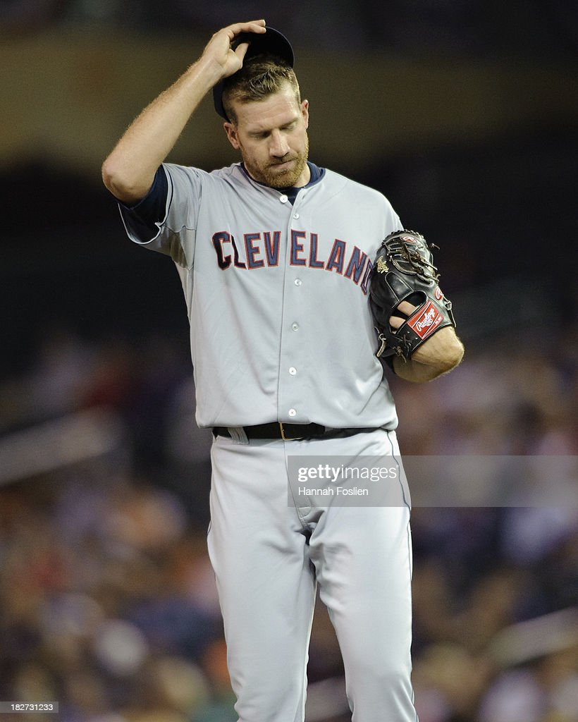 Zach McAllister #34 of the Cleveland Indians reacts during the game against the Minnesota Twins on September 26, 2013 at Target Field in Minneapolis, Minnesota.