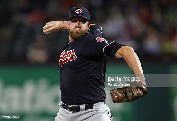 Zach McAllister of the Cleveland Indians throws against the Texas Rangers in the eighth inning at Globe Life Park in Arlington on August 25 2016 in...