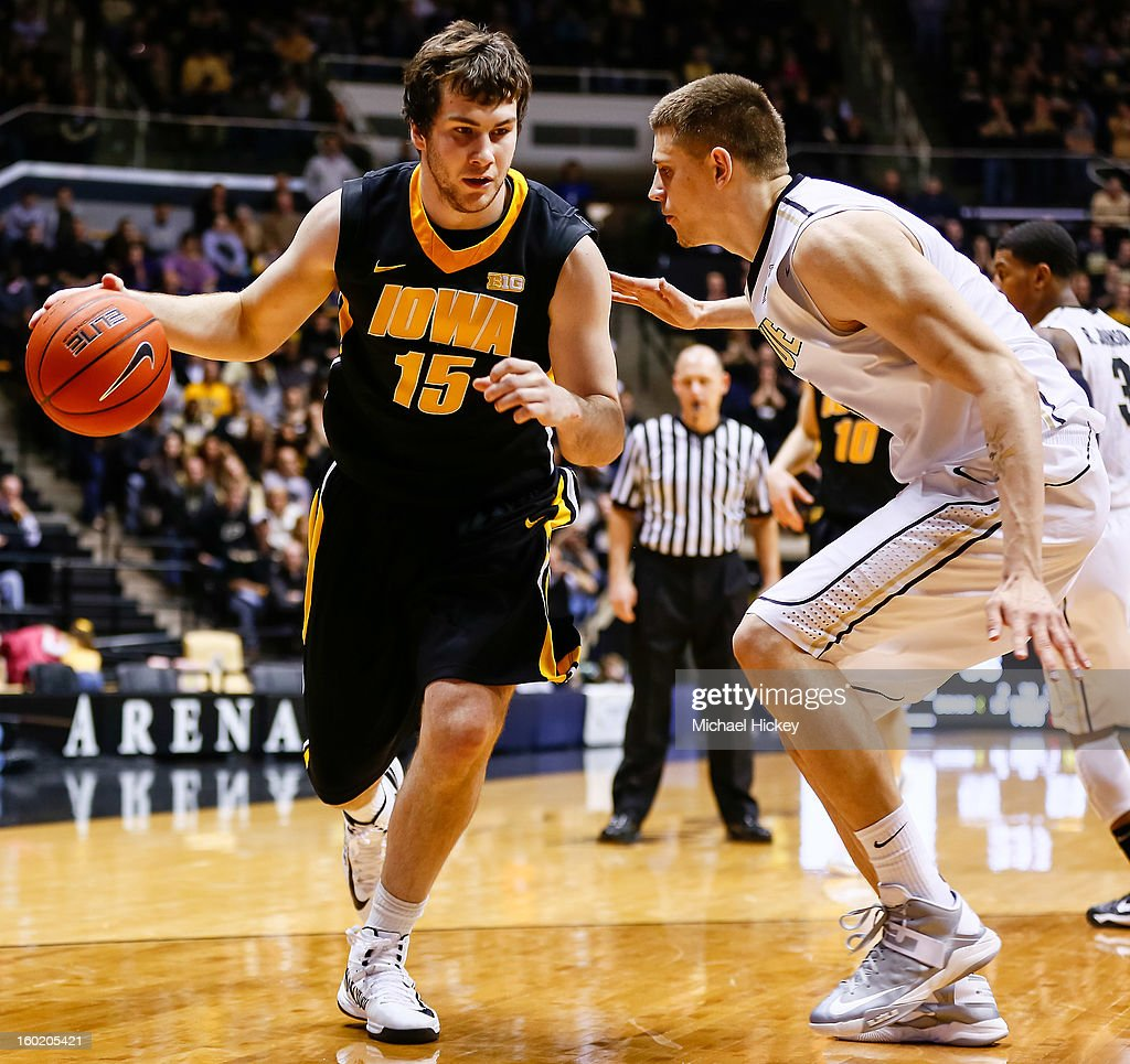 Zach McCabe #15 of the Iowa Hawkeyes dribbles against Donnie Hale #15 of the Purdue Boilermakers at Mackey Arena on January 27, 2013 in West Lafayette, Indiana. Purdue defeated Iowa 65-62 in overtime.