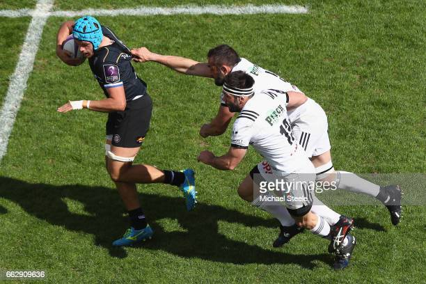 Zach Mercer of Bath breaks clear of Arnaud Mignardi and Arnaud Mela of Brive during the European Rugby Challenge Cup Quarter Final match between Bath...