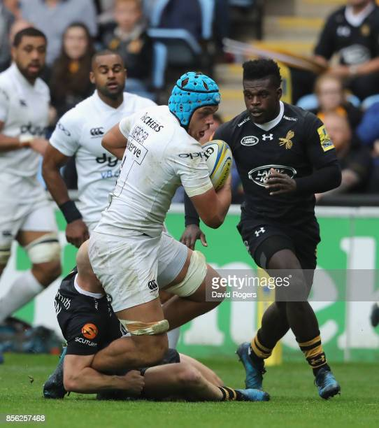 Zach Mercer of Bath is tackled by Joe Simpson and Christian Wade during the Aviva Premiership match between Wasps and Bath Rugby at The Ricoh Arena...