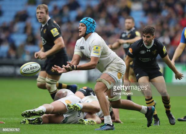 Zach Mercer of Bath passes the ball during the Aviva Premiership match between Wasps and Bath Rugby at The Ricoh Arena on October 1 2017 in Coventry...