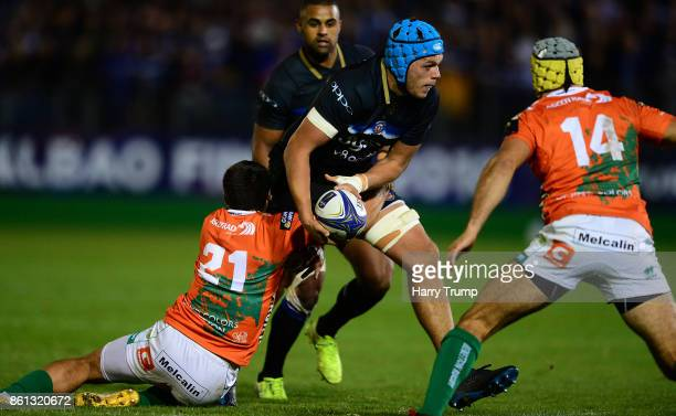 Zach Mercer of Bath Rugby is tackled by Edoardo Gori of Benetton Rugby during the European Rugby Champions Cup match between Bath Rugby and Benetton...