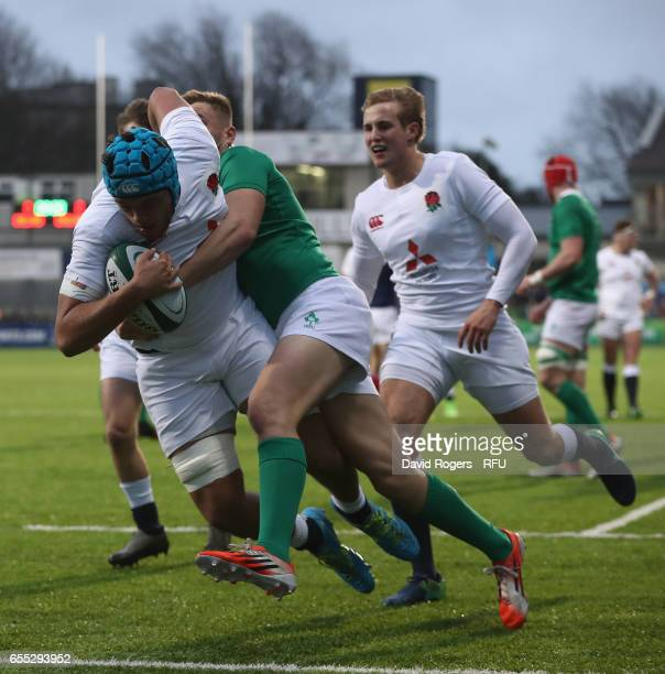 Zach Mercer of England is held by Jordan Larmour during the under 20 Six Nations Rugby Championship match between Ireland and England at Donnybrook...