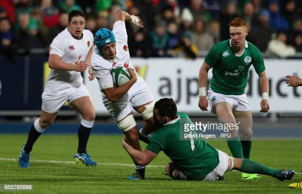 Zach Mercer of England is tackled by Paul Boyle during the under 20 Six Nations Rugby Championship match between Ireland and England at Donnybrook...