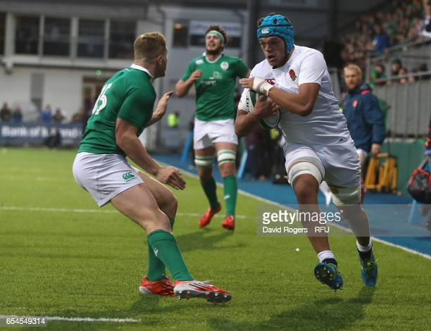 Zach Mercer of England takes on Jordan Larmour during the under 20 Six Nations Rugby Championship match between Ireland and England at Donnybrook...