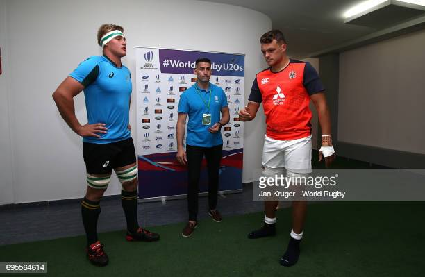 Zach Mercer of England tosses the coin with Ernst van Rhyn of South Africa looking on during the World Rugby U20 Championship semi final match...