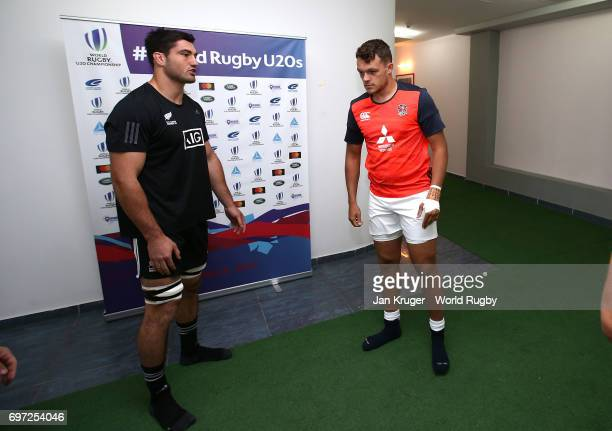 Zach Mercer of England tosses the coin with Luke Jacobson of New Zealand looking on during the World Rugby U20 Championship final match between...