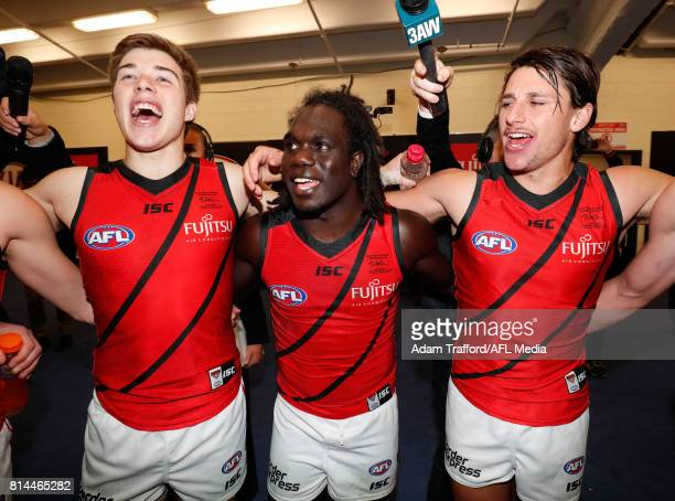 Zach Merrett Anthony McDonaldTipungwuti and Mark Baguley of the Bombers sing the team song during the 2017 AFL round 17 match between the St Kilda...
