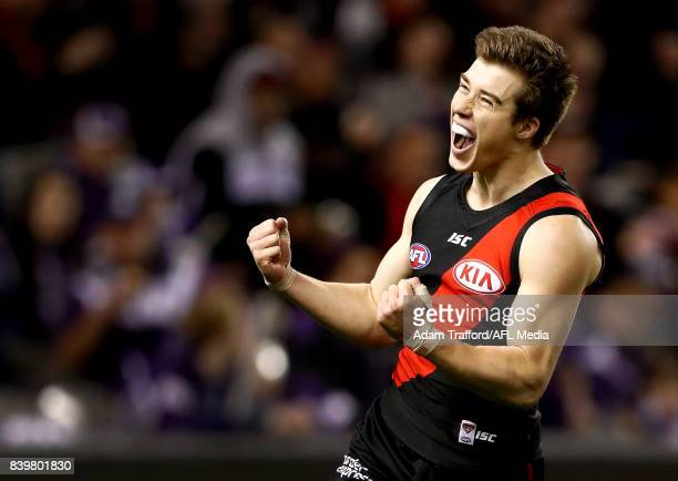 Zach Merrett of the Bombers celebrates a goal during the 2017 AFL round 23 match between the Essendon Bombers and the Fremantle Dockers at Etihad...