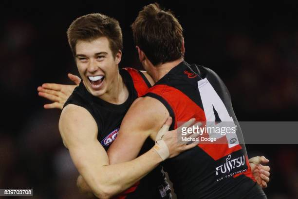 Zach Merrett of the Bombers celebrates a goal with Jobe Watson of the Bombers during the round 23 AFL match between the Essendon Bombers and the...