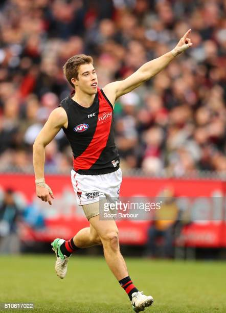 Zach Merrett of the Bombers celebrates after kicking a goal during the round 16 AFL match between the Collingwood Magpies and the Essendon Bombers at...