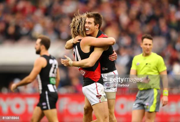Zach Merrett of the Bombers celebrates after kicking a goal with Dyson Heppell of the Bombers during the round 16 AFL match between the Collingwood...