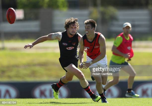 Zach Merrett of the Bombers handballs during the Essendon Bombers AFL intraclub match at True Value Solar Centre on February 8 2017 in Melbourne...