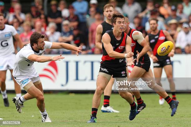 Zach Merrett of the Bombers handballs during the JLT Community Series AFL match between the Geelong Cats and the Essendon Bombers at Queen Elizabeth...