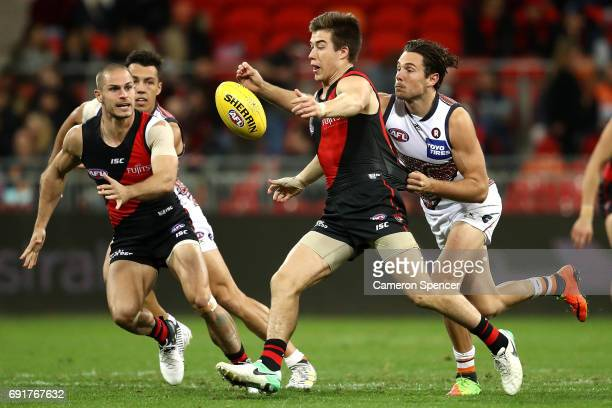 Zach Merrett of the Bombers kicks during the round 11 AFL match between the Greater Western Sydney Giants and the Essendon Bombers at Spotless...