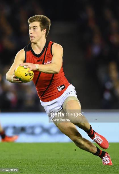 Zach Merrett of the Bombers kicks during the round 17 AFL match between the St Kilda Saints and the Essendon Bombers at Etihad Stadium on July 14...