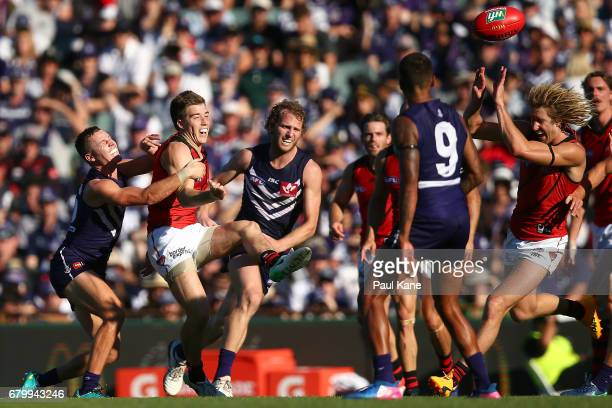 Zach Merrett of the Bombers kicks the ball during the round seven AFL match between the Fremantle Dockers and the Essendon Bombers at Domain Stadium...