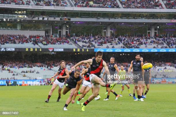Zach Merrett of the Bombers kicks the ball kicks the ball during the round three AFL match between the Carlton Blues and the Essendon Bombers at...