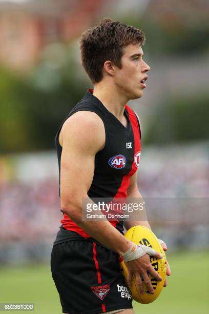Zach Merrett of the Bombers looks on during the JLT Community Series AFL match between the Geelong Cats and the Essendon Bombers at Queen Elizabeth...
