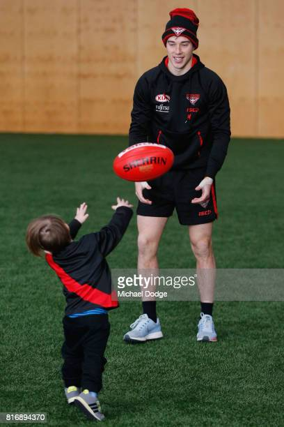 Zach Merrett of the Bombers plays with a young fan from childrens childrens cancer charity Challenge during an Essendon Bombers AFL media opportunity...