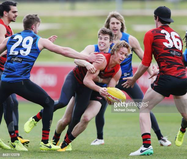 Zach Merrett of the Bombers tackles Darcy Parish of the Bombers during an Essendon Bombers AFL training session at the Essendon Football Club on...
