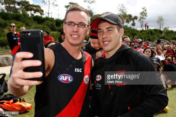 Zach Merrett poses for a selfie with a fan during the Essendon Bombers AFL Family Day at Essendon Football Club on February 19 2017 in Melbourne...