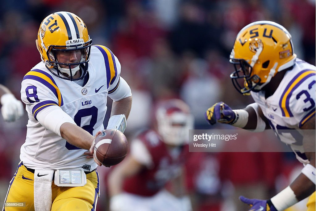<a gi-track='captionPersonalityLinkClicked' href=/galleries/search?phrase=Zach+Mettenberger&family=editorial&specificpeople=6548476 ng-click='$event.stopPropagation()'>Zach Mettenberger</a> #8 hands off the ball to Jeremy Hill #33 of the LSU Tigers talks during a game against the Arkansas Razorbacks at Razorback Stadium on November 23, 2012 in Fayetteville, Arkansas. The Tigers defeated the Razorbacks 20-13.