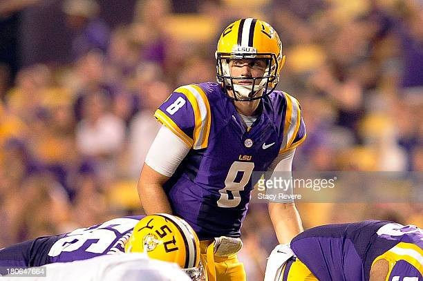 Zach Mettenberger of the LSU Tigers calls a play at the line of scrimmage against the Kent State Golden Flashes during a game at Tiger Stadium on...